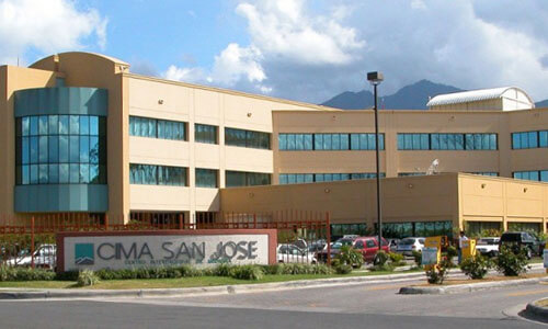 Picture of CIMA Hospital, Costa Rica's premier advanced Hospital in San Jose, Costa Rica.  The picture shows a large sprawling medical complex with light brown colors.